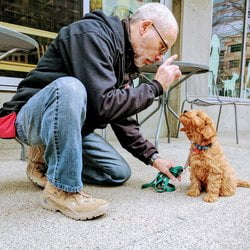 dog trainer with puppy